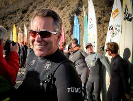 Surfer Jeff Clark smiles during the opening ceremony for the Mavericks Surf Contest at Mavericks Beach in Princeton by the Sea, Calif., on Friday, November 9th, 2012