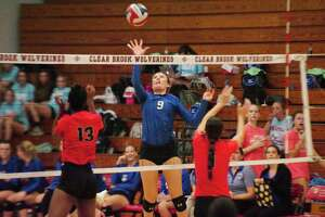 Friendswood's Lauren Hubbard (9) tips the ball over the net against Clear Brook Tuesday, Oct 10.