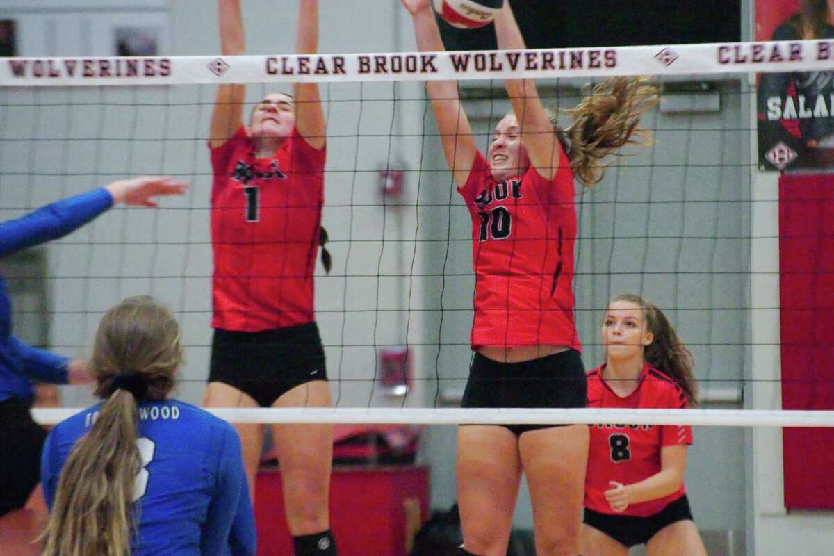 Clear Brook's Sydney Saladrigas (1) and Clear Brook's Gabby Wilcox (10) put up a block against Friendswood Tuesday, Oct 10.