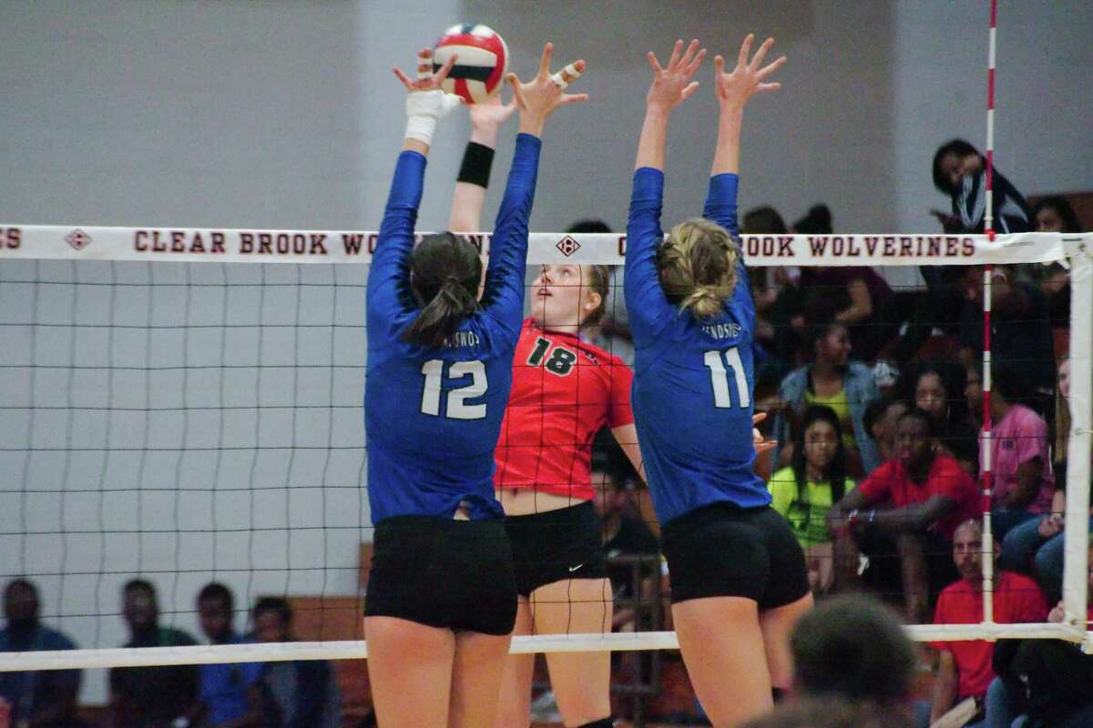 Clear Brook's Jordan Russell (18) tires to hit a shot past Friendswood's Natalie Abowd (12) and Friendswood's Faith Marabella (11) Tuesday, Oct 10.