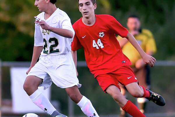 Notre Dame-West Haven freshman defender Zachary Zanzalari controls the ball as Cheshire sophomore midfielder Gautier Pez defends, Tuesday, Oct. 10, 2017, at Veterans Stadium in New Haven. Cheshire defeated Notre Dame-West Haven, 2-1.