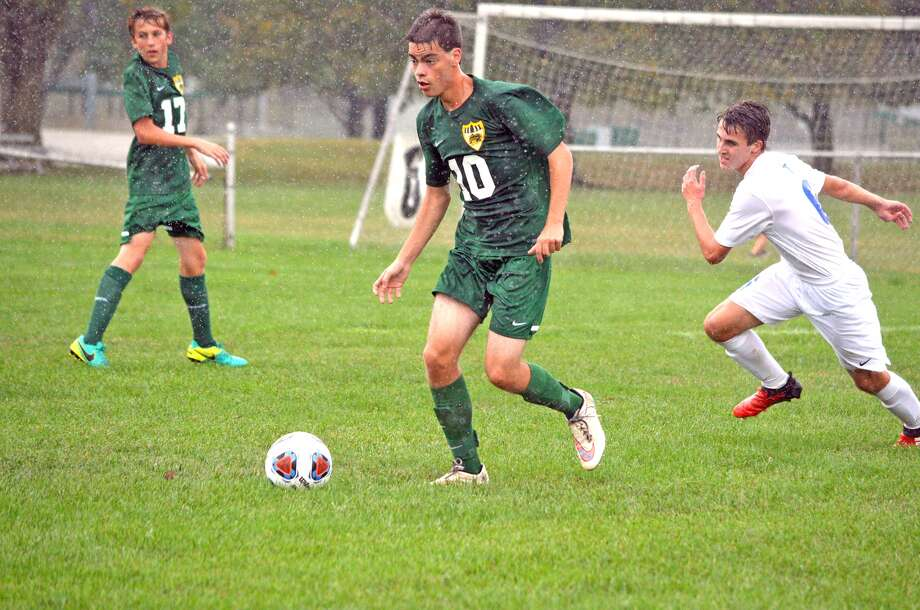 Metro-East Lutheran senior Eric Jones controls the ball during the first half of Tuesday's regional semifinal against Alton Marquette at Gordon Moore Park.