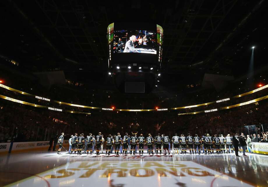 The Golden Knights and Coyotes stand during the national anthem, part of a stirring pregame ceremony that honored first responders and victims of last week's Las Vegas shooting. Photo: Bruce Bennett