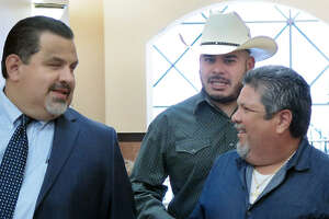 City Councilman, District 2, Vidal Rodriguez, wearing cowboy hat, is accompanied by two men as he makes his way to the County Court at Law #1, Tuesday, October 10, 2017, for his sentencing hearing for charges related to the dissemination of confidential records in December 2015.