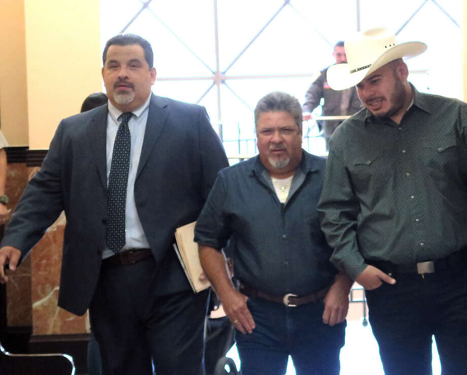 City Councilman, District 2, Vidal Rodriguez, wearing cowboy hat, is accompanied by two men as he makes his way to the County Court at Law #1, Tuesday, October 10, 2017, for his sentencing hearing for charges related to the dissemination of confidential records in December 2015. Photo: Cuate Santos/Laredo Morning Times