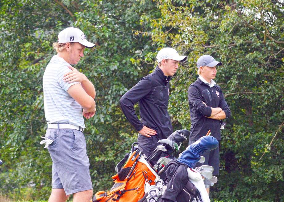 Edwardsville golfers, from left to right, Jon Ratterman, Lucas Verdun and Colin Loyet, await their turn to play during a practice earlier this season.