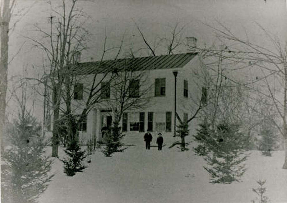 Circa 1880 image of the former Blessing Homestead on the corner of Cherry Avenue and Orchard Street (formerly called Jericho Road and Stony Hill Road), Delmar. The three people in the photo are believed to be Magdalene Blessing and two of her four sons, Frederick Jr., Elwood, Frank, and Charles. Photo: Bethlehem Public Library/New York Heritage