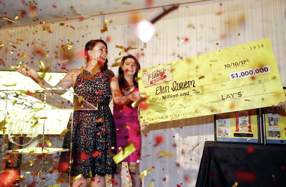 """Jennifer Saenz, Frito-Lay North America chief marketing officer, awards Ellen Sarem, left, from San Antonio, Texas the $1 million grand prize in this year's Lay's """"Do Us a Flavor"""" contest on Tuesday, Oct. 10, 2017 in Dallas. Photo: Brandon Wade /Associated Press / AP IMAGES"""