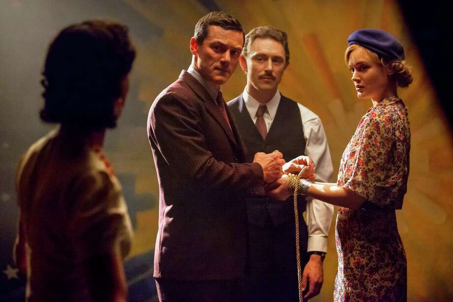 PMWW_02816_R (l-r.) Rebecca Hall stars as Elizabeth Marston, Luke Evans as Dr. William Marston, JJ Feild as Charles Guyette and Bella Heathcote as Olive Byrne in PROFESSOR MARSTON AND THE WONDER WOMEN, an Annapurna Pictures release. Credit: Claire Folger / Annapurna Pictures Photo: Claire Folger
