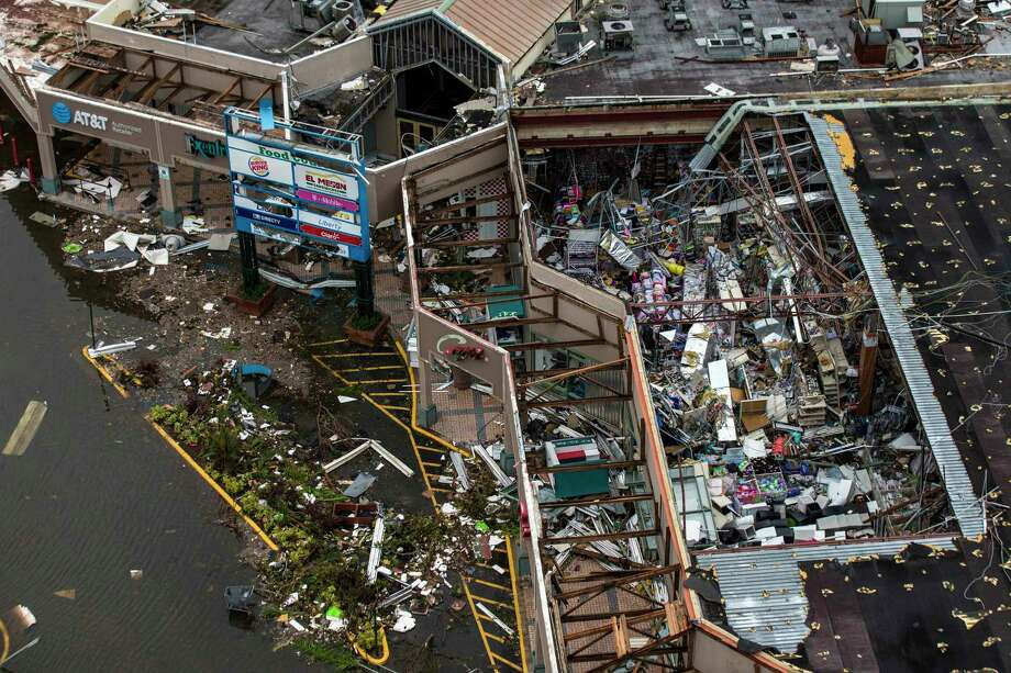 Debris covers the interior of a building with a destroyed roof at the Palma Real Shopping Center in Humacao on Sept. 22, two days after Hurricane Maria devastated large areas of Puerto Rico. Photo: Dennis M. Rivera Pichardo For The Washington Post. / Dennis M. Rivera Pichardo