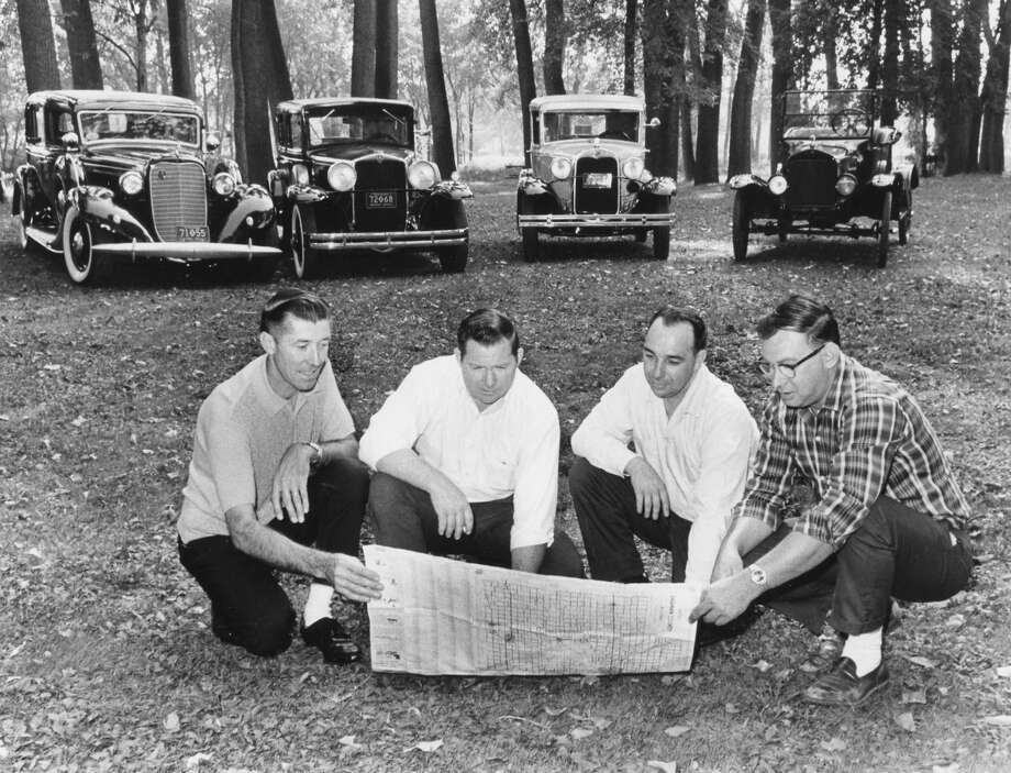 "From left, George Siebert, '35 Lincoln; Donald Frost, Hupmobile; William Lape, '30 Ford two door, and Gerald ""Jerry"" Brisson, '24 Ford Roadster, leaders of the Central Michigan Old Car Club, make plans in Emerson Park for the eighth annual fall meet. September 1967 Photo: Daily News File Photo"