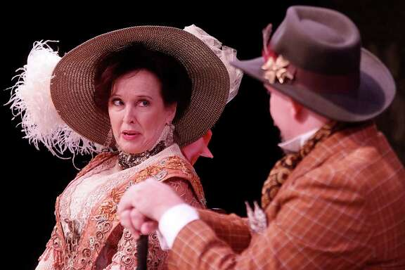 """Celeste Roberts as Kitty Warren and Tom Long as Sir George Crofts in the Classical Theatre Company's production of """"Mrs. Warren's Profession."""""""