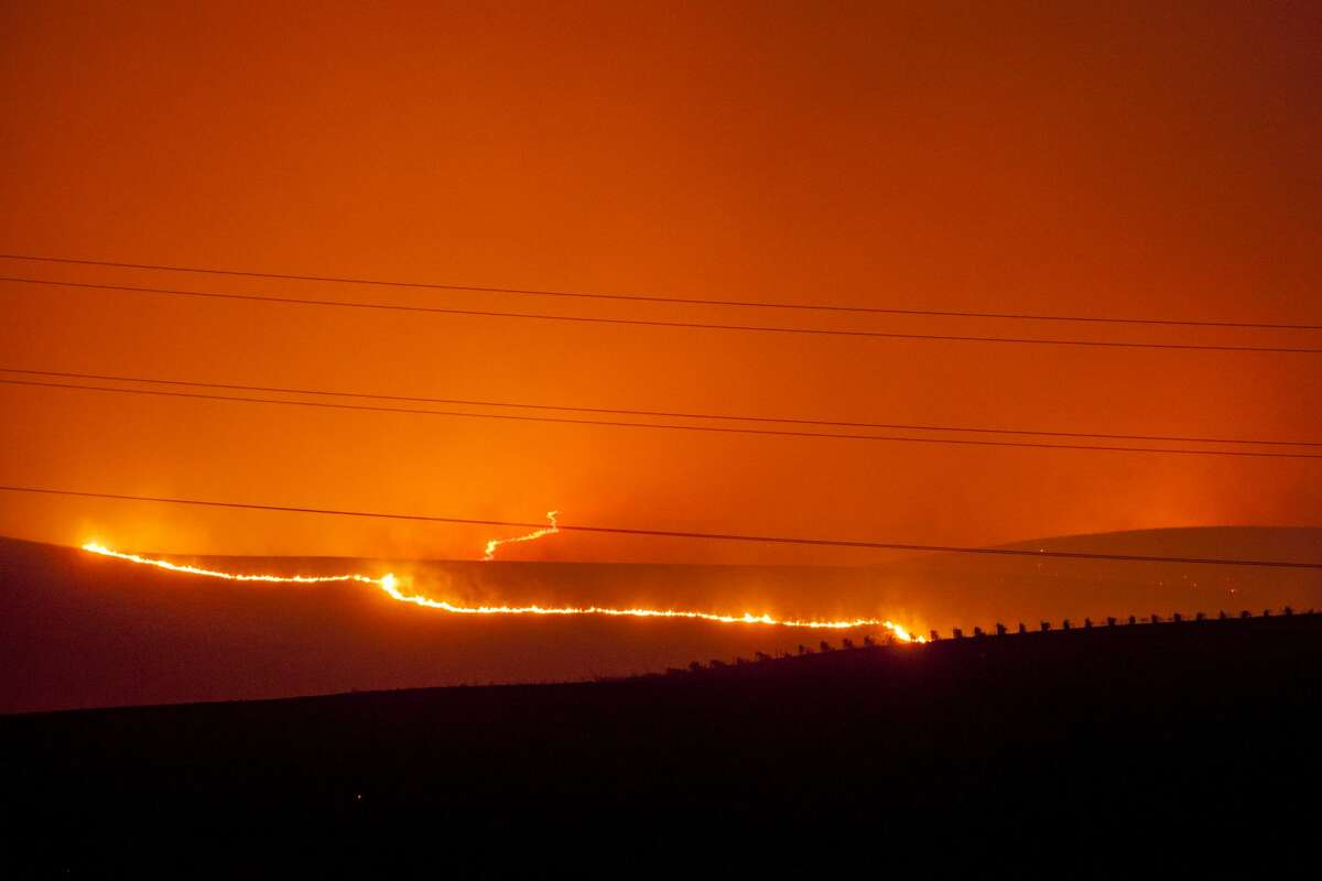 Flames moved through the vineyards as a fast moving wind whipped wild fire raged though the Napa/Sonoma wine region in NAPA, CALIFORNIA, USA 9 Oct 2017. Multiple fire that erupted in Napa, Sonoma, Calistoga and the Santa Rosa area have burned homes and wineries. Mandatory evacuations have be displaced hundreds of residents through out the area.
