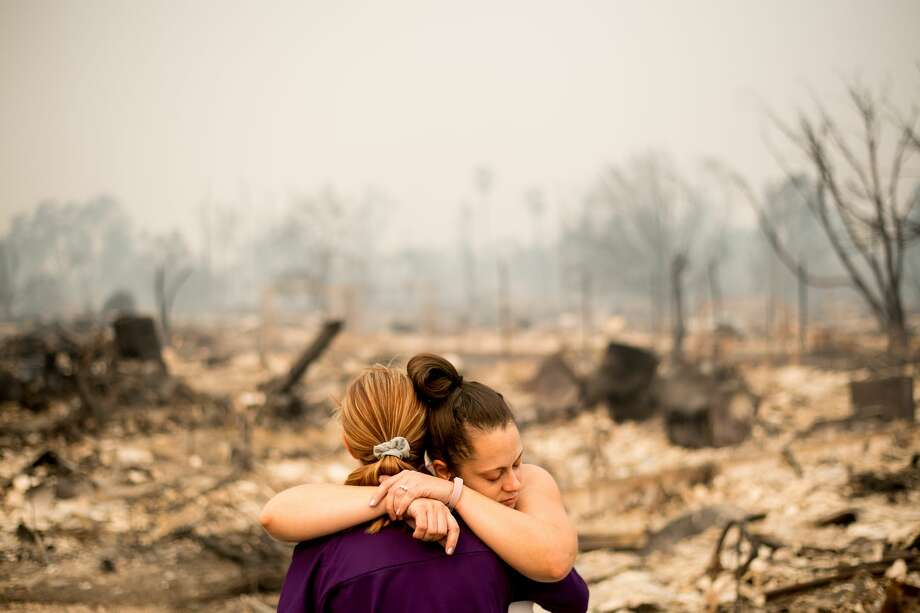 Lori Sarver hugs neighbor Denise Zaleski while searching through the remains of her home in the Coffey Park neighborhood of Santa Rosa, on Oct. 10, 2017. Photo: Noah Berger/Special To The Chronicle