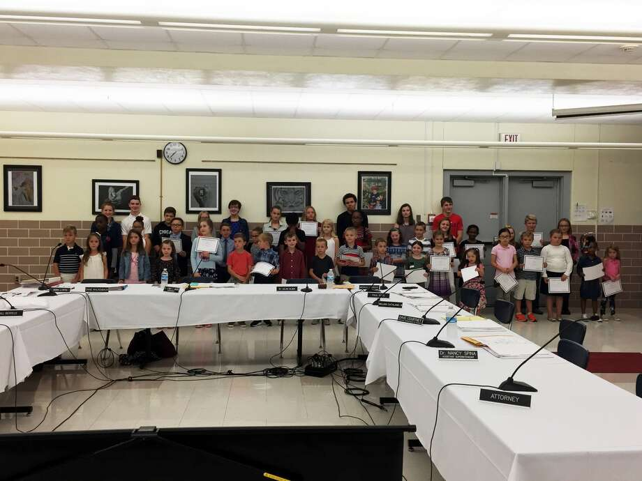 The Edwardsville District 7 Board of Education recognized October's Do The Right Thing Award winners at Tuesday's meeting. They are: James Scott, Landon Vuagniaux, Emily Leanne Anderson, Destiny Hope, Tyrone Jones and Brittany Jett from Edwardsville High School; Alayna Ahlers, Vyla Hupp, Paige Bryne and Rebecca Thomas from Liberty Middle School; Grace Kirkpatrick, Emma Patrick, Rachel Heflin, George Windaue and Blake Freitag from Lincoln Middle School; Gwen Harkey, Chase Wulfing and Mariae Jones from Columbus Elementary; Brooklyn Elliot, Sally Schapman, Shreyas Medikonda and Zack Kennett from Cassens Elementary; Knox Verbais, Darwin Chimaren and Paris Appleby from Woodland Elementary; Kendra Englar, Caden Hamilton and Laura Gusewelle from Worden Elementary; Hayden Hoelscher, Kei Blake and Kennedy Downs from Glen Carbon Elementary; Max Maloney, Ester Steele, Allison Huang from Nelson Elementary; Gavin LaCuesta, Jessica Sever and Aubrey Hines from Hamel Elementary; Marek Neese, Parker Curry and Sean Ogden from Midway Elementary; Nolan McKinney, Bowen Volling and Marleena Anderson from Leclaire Elementary; and Madison McLeland, Mason McLeland, Reagan Farris and Kenley Stowe from Goshen Elementary. Photo: Julia Biggs • Jbiggs.edwi@gmail.com