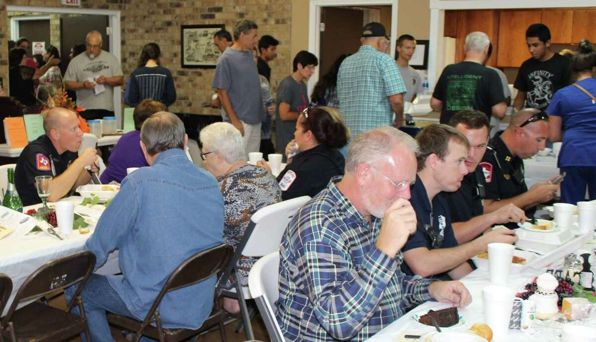 Citizens of Roman Forest enjoy dinner and the company of local law enforcement, EMS workers, firefighters and city officials during National Night Out on Oct. 4.