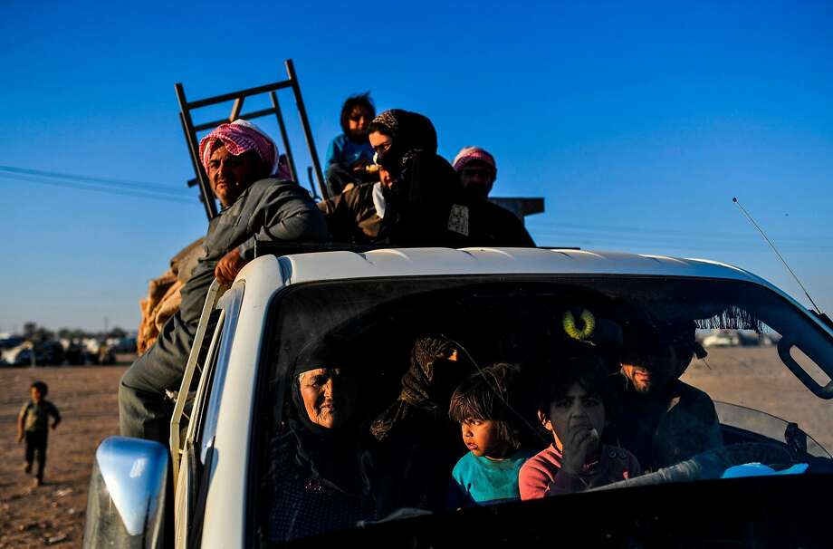 Displaced civilians arrive on the outskirts of Raqqa as U.S.-backed forces prepare to recapture the city. Photo: BULENT KILIC, AFP/Getty Images