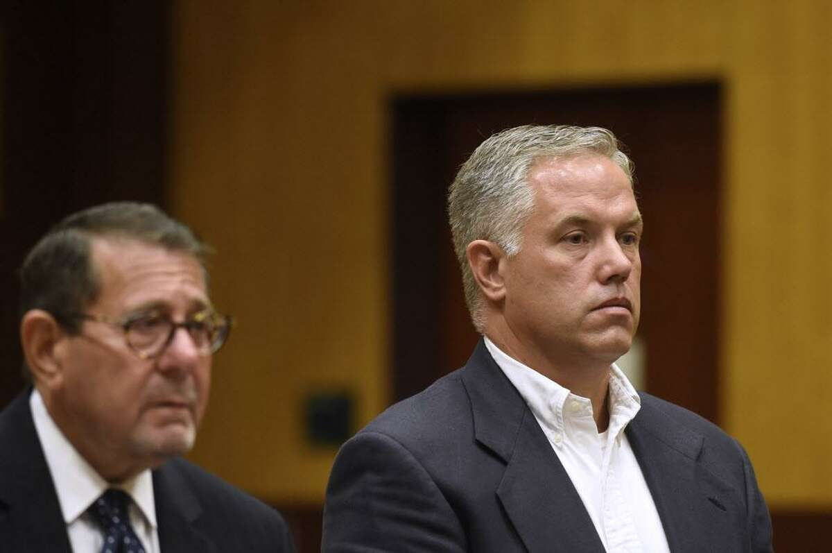 Mark Cusson, right, stands before a judge during his arraignment on patient abuse charges at Middletown Superior Court Sept. 7. Cusson and seven other workers from Whiting Forensic at Connecticut Valley Hospital were arraigned on abuse charges. Cusson is charged with eight counts of cruelty to persons and eight counts of disorderly conduct. His attorney. Brian J. Woolf, is at left.