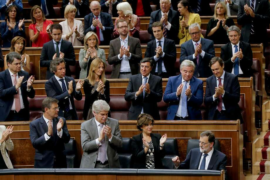 Prime Minister Mariano Rajoy (bottom right) is applauded after telling the Spanish parliament that he rejected offers of mediation in the Catalonia crisis, and called for respect of law. Photo: Paul White, Associated Press