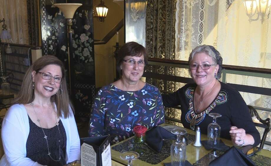 From left are Lisa Soliani, Hatfield Jewelers, Lynn Gelormino, Warner Theatre and Karen O'Donnell, Remember When, who met to discuss Friday's Creepy Crawl event in Torrington. Photo: Photo By Theresa Channell / Not For Resale