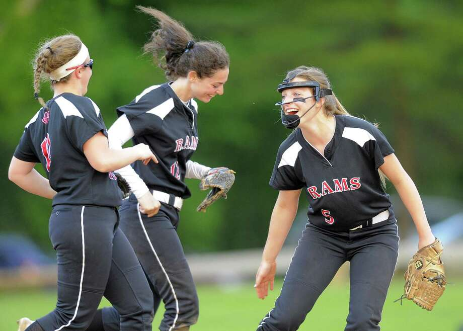 New Canann pitcher Gillian Kane, at right, celebrates with teammates after a great catch by Kara Fahey, center, in a softball game against Westhill last season. Photo: Matthew Brown / Hearst Connecticut Media / Stamford Advocate