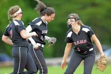 New Canann pitcher Gillian Kane, at right, celebrates with teammates after a great catch by Kara Fahey, center, in a softball game against Westhill last season.