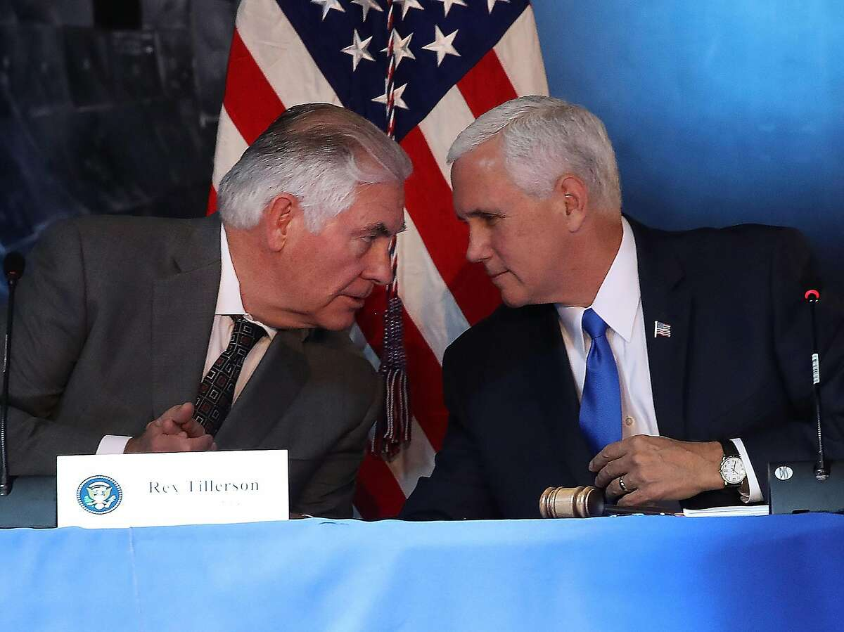 """CHANTILLY, VA - OCTOBER 05: Vice President Mike Pence (R), and Secretary of State Rex Tillerson participate in the inaugural meeting of the National Space Council, titled """"Leading the Next Frontier"""" at the National Air and Space Museum, Steven F. Udvar-Hazy Center, October 5, 2017 in Chantilly, Virginia. Originally established in 1958, this is the first meeting of the newly reestablished council in 20 years. (Photo by Mark Wilson/Getty Images) *** BESTPIX ***"""