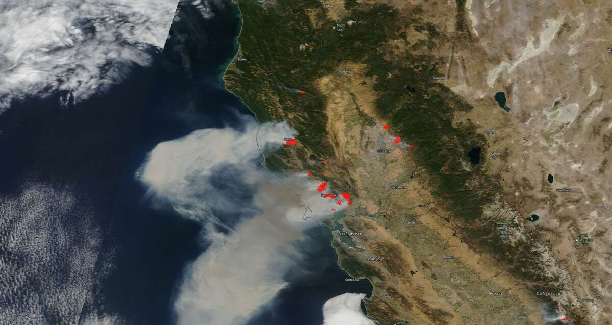 NASA's satellites captured the smoke from Northern California wildfires. The red dots indicate where fires are burning.