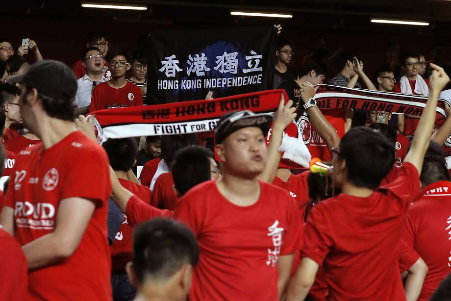 "Hong Kong soccer fans boo the Chinese national anthem and chant banner ""Hong Kong Independence"" during the AFC Asian Cup 2019 qualification soccer match against Malaysia, in Hong Kong, Tuesday, Oct. 10, 2017. (AP Photo/Kin Cheung) Photo: Kin Cheung, Associated Press"