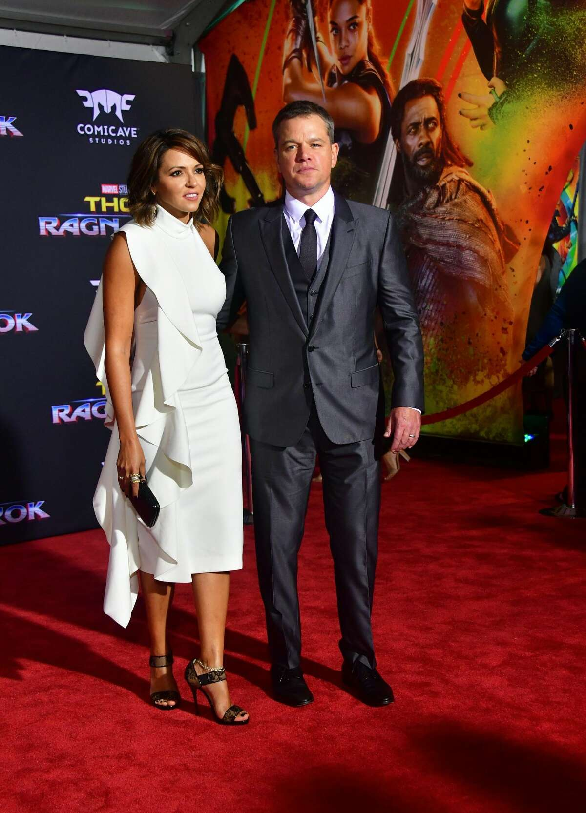 Actor Matt Damon and his wife Luciana Barrosso arrive for the premiere of the film