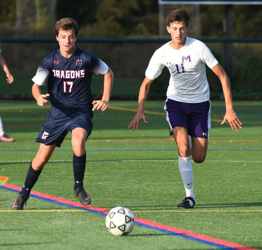 The Greens Farms Academy boys soccer team stunned The Masters School of New York 1-0 on Friday, scoring the game-winning goal with 29 seconds left to play. At left, Charlie Benson of Darien contemplates his next move while facing Masters. Photo: Contributed Photo