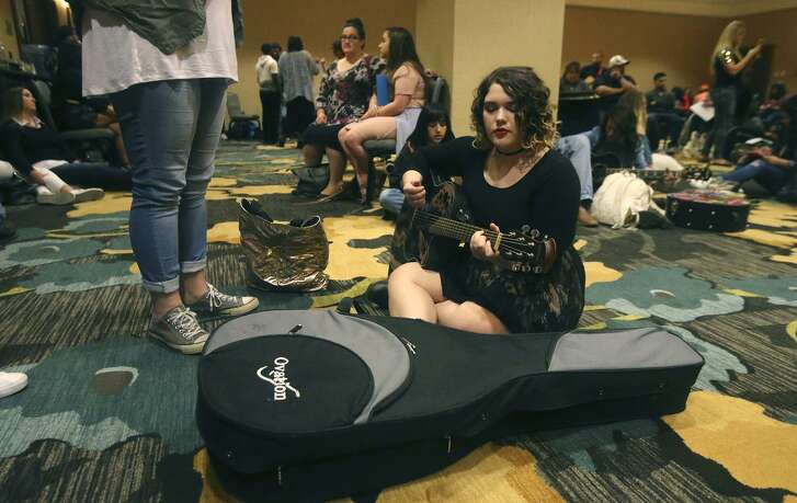 """Avery Landrum,15, strums her guitar and sings as she waits to audition for """"American Idol,"""" which ABC is bringing back to TV next year."""