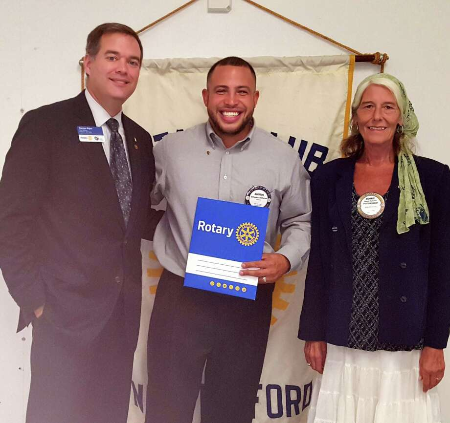 The New Milford Rotary Club recently inducted a new member, Alfredo Calderon, at its Aug. 15 meeting. Calderon, a branch manager for Union Savings Bank in New Milford, resides in Danbury with his wife, Sheri, and their four children. He is shown above, center, with Rotary President Darren Piper and Rotarian sponsor Bonnie Blackman. Photo: Courtesy Of Rotary Club Of New Milford / The News-Times Contributed