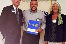 The New Milford Rotary Club recently inducted a new member, Alfredo Calderon, at its Aug. 15 meeting. Calderon, a branch manager for Union Savings Bank in New Milford, resides in Danbury with his wife, Sheri, and their four children. He is shown above, center, with Rotary President Darren Piper and Rotarian sponsor Bonnie Blackman.