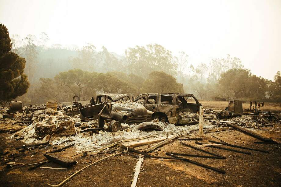 The remains of vehicles can be seen where a barn was destroyed in Gundlach Bundschu Winery in Sonoma, Calif. Wednesday, October 11, 2017. Photo: Mason Trinca, Special To The Chronicle