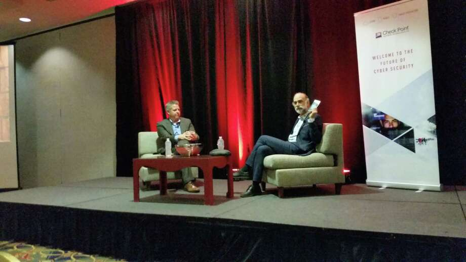 Bruce Schneier, an internationally-known cybersecurity expert, left, speaks with Reg Harnish, CEO of GreyCastle Security. Photo: Brian Nearing
