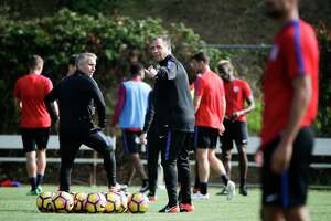 U.S. men's national soccer team coach Bruce Arena, center, gestures during a practice session Wednesday, Jan. 11, 2017, in Carson, Calif.