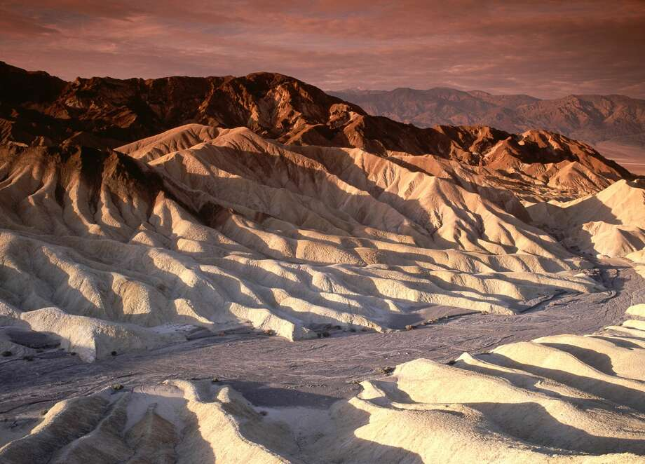 Former National Geographic travel photographer, Jonathan Irish, and NASA employee, Stephanie Payne, visited all of the national parks in 2016 and Death Valley National Park, shown here, is one of 12 they say everyone should visit. Click through to see the others. >>> Photo: LICreate/Getty Images