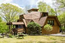 The unique contemporary at 35 Sawyer Hill in New Milford was designed by the owner to be energy efficient. It features a 10-sided geodesic dome.