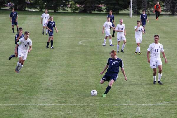Alan Stinson(11) dribbling. The Shepaug High School boys soccer team continues to improve and work toward its goal of reaching the postseason as the home stretch of the regular season gets underway.