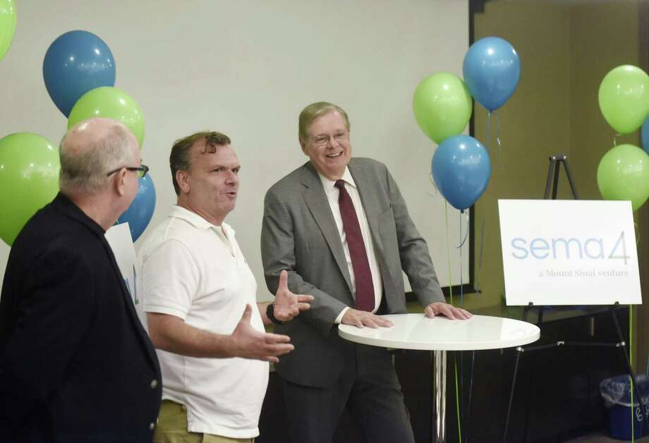 "Sema4 President and COO James Coffin, Ph.D., left, CEO Eric Schadt, Ph.D., center, and Stamford Mayor David Martin speak at the Sema4 headquarters in Stamford, Conn. Wednesday, Oct. 11, 2017. Sema4 is a new company spun out of the Mount Sinai Health System that ""will use genomic and clinical data to empower more informed health decisions and enhance care and wellness."" Photo: Tyler Sizemore / Hearst Connecticut Media / Greenwich Time"