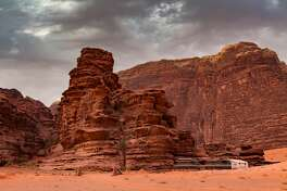 Jordanian desert in Wadi Rum, Jordan at sunset. Wadi Rum is known as The Valley of the Moon and has led to its designation as a UNESCO World Heritage Site.