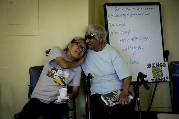 Volunteer Marilyn Chan hugs Francisca Joanilho (right) ahead of playing bingo at the Curry Senior Center in San Francisco, Calif., on Wednesday, Sept. 27, 2017.