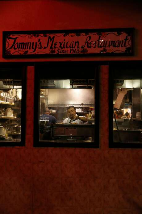 Longtime chef Rafael Granados cooks in the kitchen at Tommy's Mexican Restaurant on Geary Boulevard. The family restaurant opened in 1965, serving Yucatan-style food. Photo: Liz Hafalia, The Chronicle