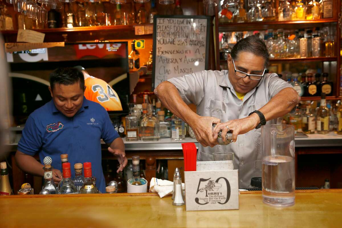 Julio Bermejo (right) makes drinks at the bar at Tommy's Mexican restaurant on Friday, September 29, 2017, in San Francisco, Calif.