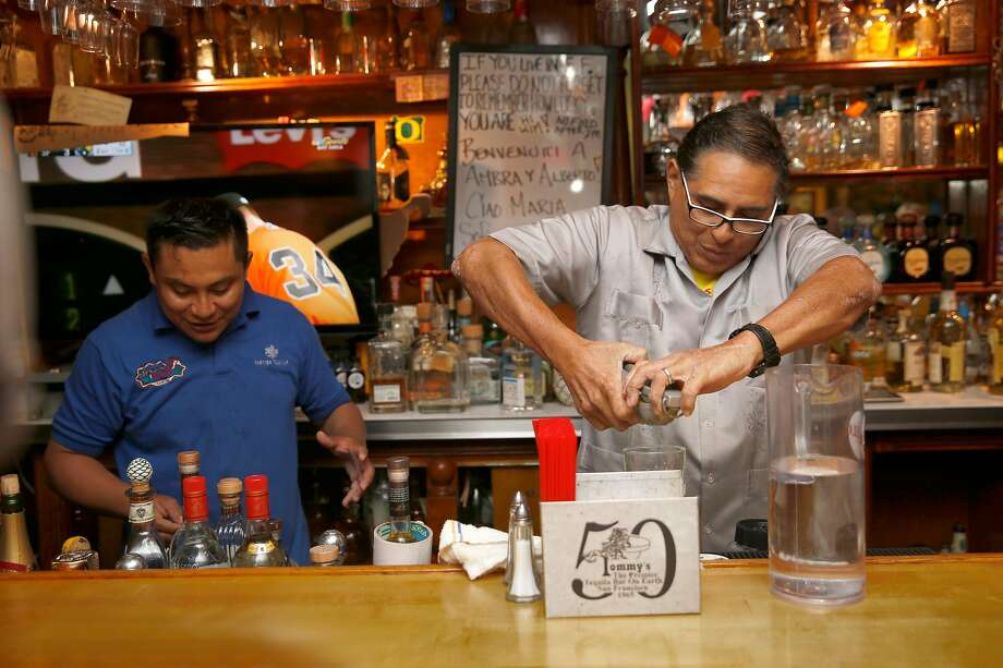 Julio Bermejo (right) mixes a drink at Tommy's Mexican Restaurant in the Richmond District. Bermejo grew up in the restaurant and found acclaim with the Tommy's Margarita. Photo: Liz Hafalia, The Chronicle