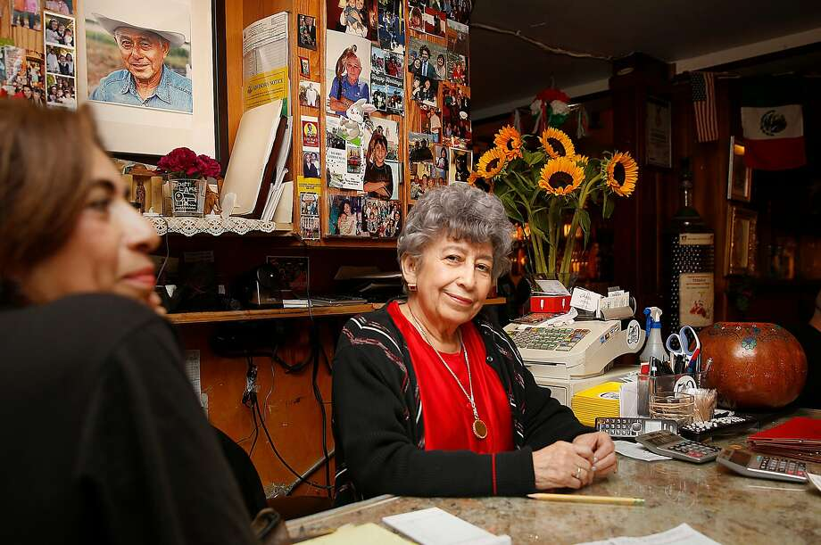 Elmy Bermejo (left) and her mom, Elmy W. Bermejo, greet customers at Tommy's Mexican Restaurant in the Richmond District. Photo: Liz Hafalia, The Chronicle