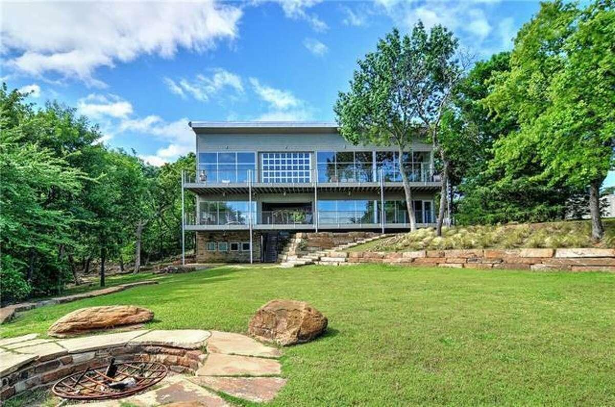 Pottsboro, Texas lake house offers uninterrupted lake views.