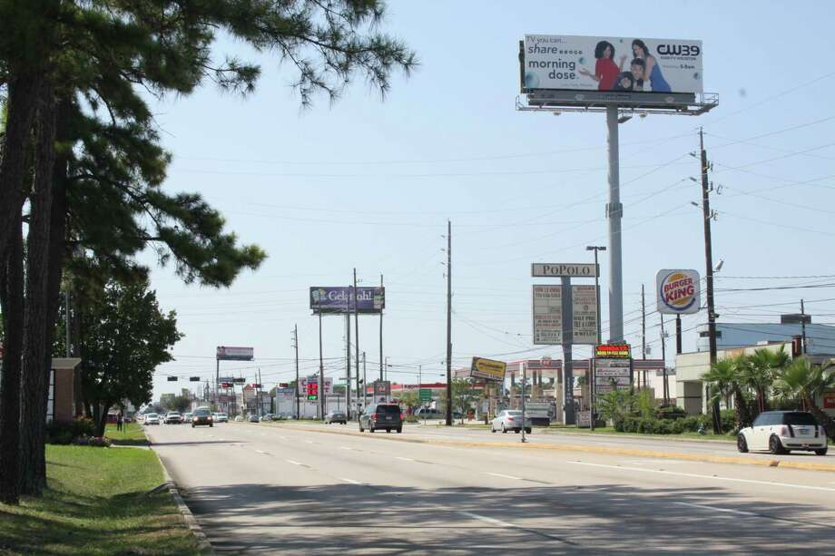 As the Texas Legislature decides whether or not to implement a rule that would allow some billboards to be as tall at 85 feet high, some organizations are attempting to remove them in northwest Houston, such as the ones along FM 1960. Photo: Mayra Cruz