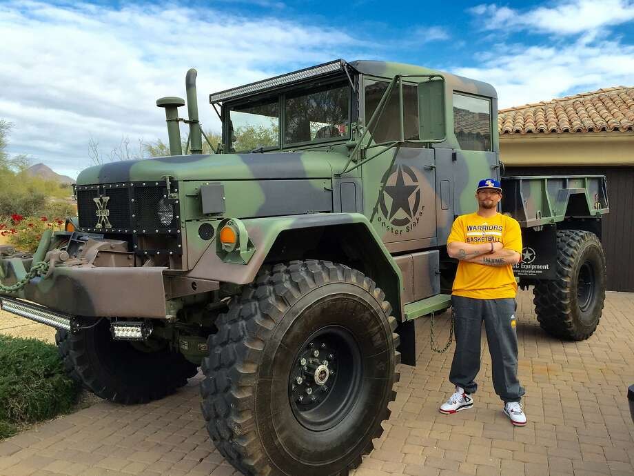 Former A's player Jonny Gomes stands next to the military truck he'll be using to help with relief efforts in Wine Country this weekend. Photo: Courtesy Jonny Gomes And C& Equipment